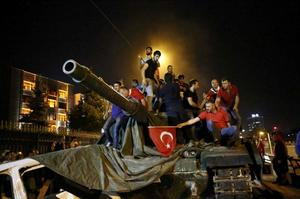 People stand on a Turkish army tank in Ankara, Turkey July 16, 2016.   REUTERS/Tumay Berkin